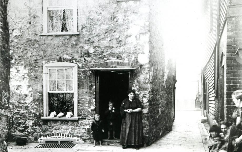 Family standing on door step 1900