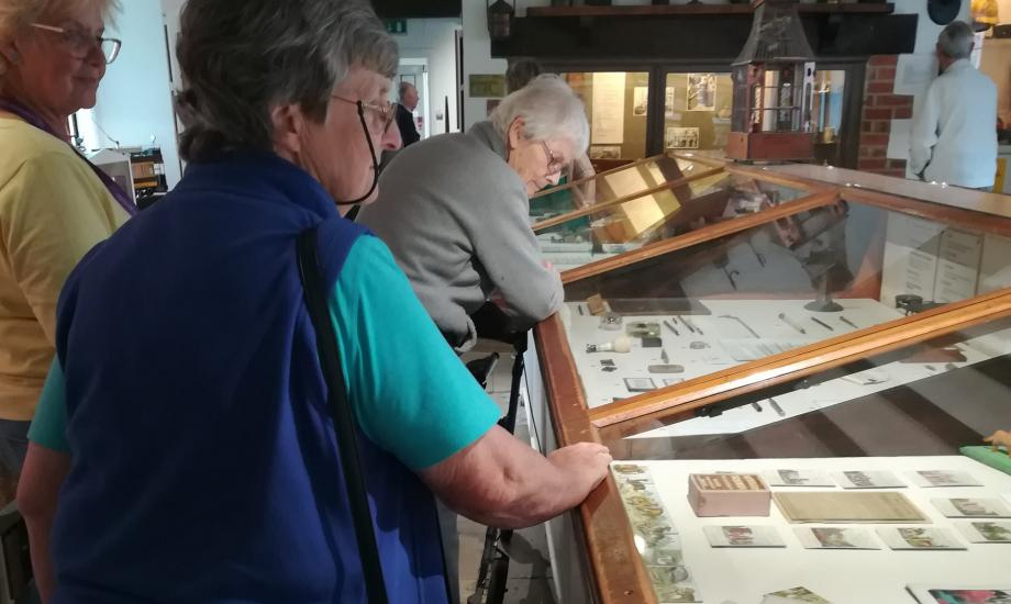 People with dementia and carers looking around museum displays