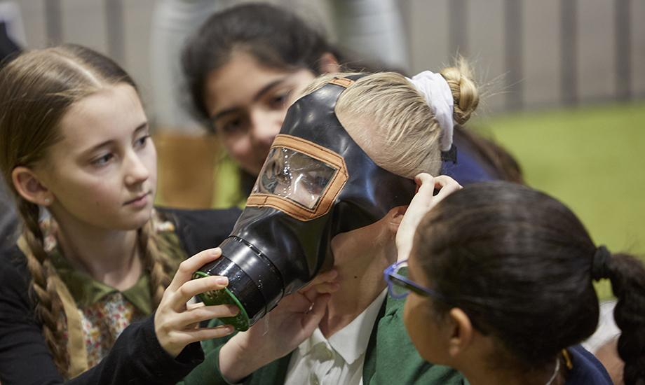 Trying a gas mask at a World War II session