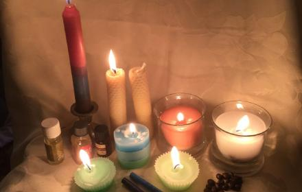 Image of various sized lit candles