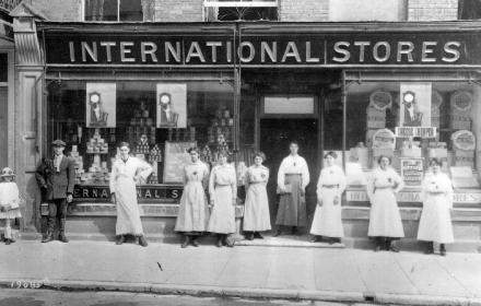 Old black and white photo outside of International Stores