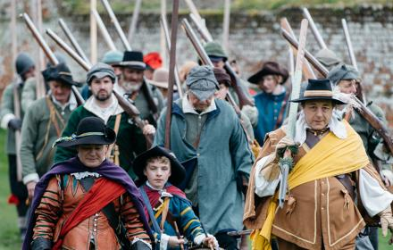 Members of the Sealed Knot marching on Basing House