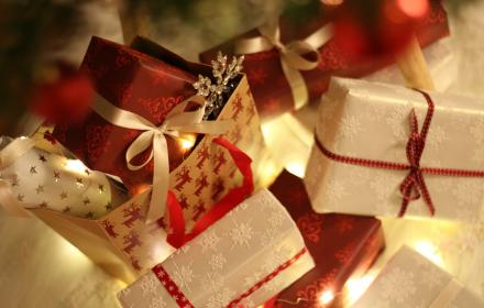 image of presents wrapped in christmas paper place in gift bag