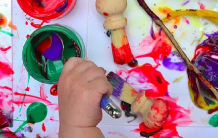 Baby hand making messy painting