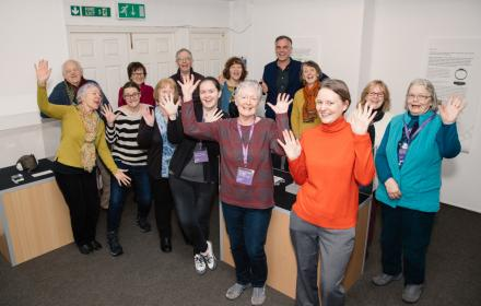 Andover Museum staff and volunteers celebrate funding success with James Aldrige from Chapel Arts Studios associate artist (centre back)